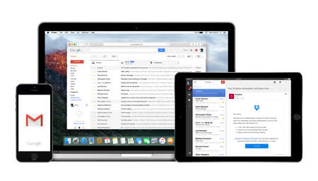 Varna, Bulgaria - February 02, 2015: Google Gmail app on the Apple iPhone iPad displays and desktop version of Gmail on the Macbook Pro. Gmail is a free e-mail service. Multiple devices kit.
