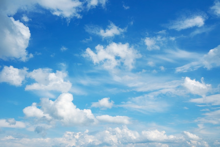 Blue sky and clouds. Beautiful cloudscape over horizon.