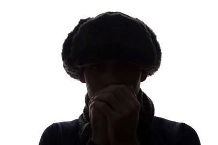 Photo pour Young man in hat and gloves look ahead - horizontal silhouette of a front view - image libre de droit