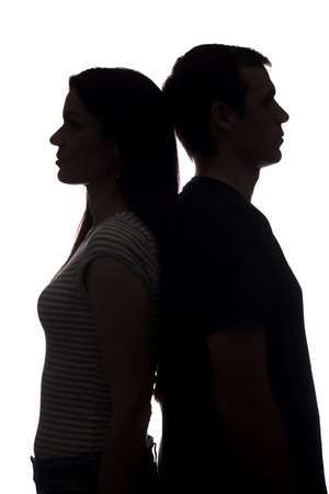 Photo for Faces women and men look in different directions, brother and sister - vertical silhouette - Royalty Free Image