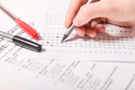 Foto de Test of English multiple choice on table.Woman takes an entrance exam. - Imagen libre de derechos