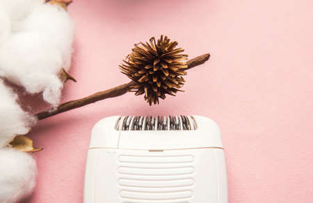 Epilator for removing unwanted hair on the body, legs, armpits and bikini area. a branch of cotton and ice.
