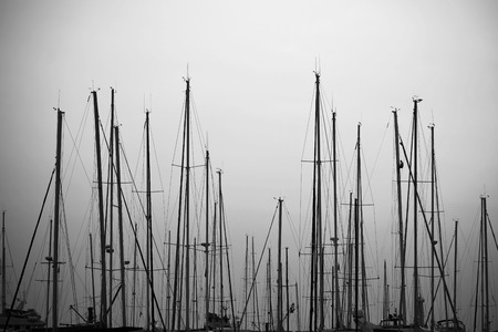 Black and white ship spars in the harbor