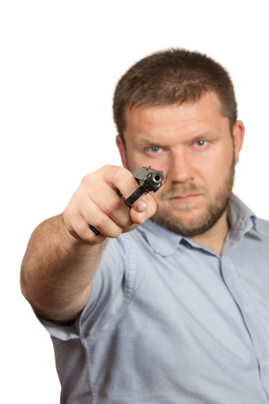 Man with mustache and beard pointed the gun towards the camera close-up isolated on white background