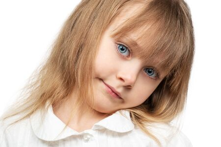 Photo pour Portrait of a beautiful little girl with blue eyes and flowing hair, close-up, isolated on white background - image libre de droit