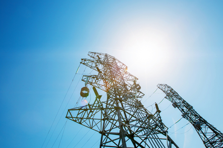 Photo for Power tower in the sky background, high-voltage post or high-voltage tower in the sunlight. High-voltage tower and electric power, high voltage - Royalty Free Image