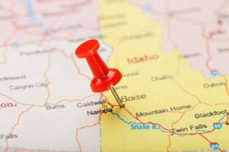 Red clerical needle on a map of USA, Idaho and the capital ...