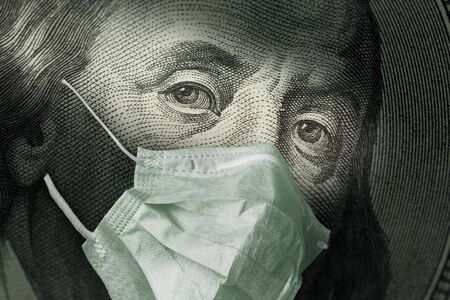 Photo pour Portrait of Benjamin Franklin 100 dollar Bills with a medical mask from the coronavirus COVID-19. The COVID virus outbreak is affecting the global stock market and economy. The concept of the Financial crisis and pandemics. - image libre de droit