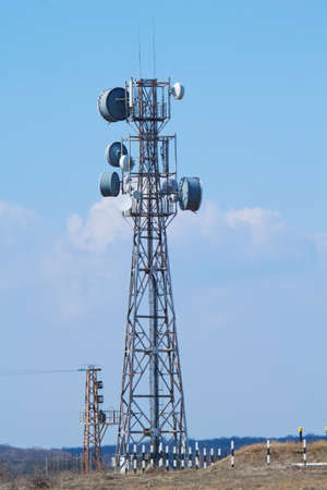 Telecomunication tower against blue sky.