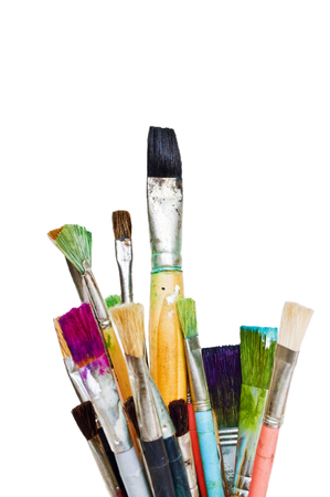 Old and used colorful paintbrushes