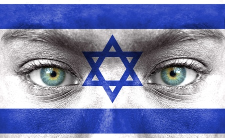 Human face painted with flag of Israel