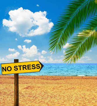 Tropical beach and direction board saying NO STRESS