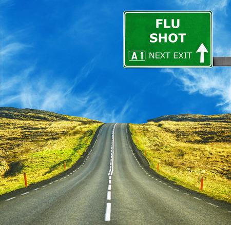 Photo pour FLU SHOT road sign against clear blue sky - image libre de droit