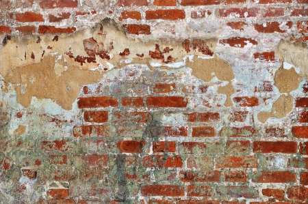 Old red bricks weathered damaged wall background