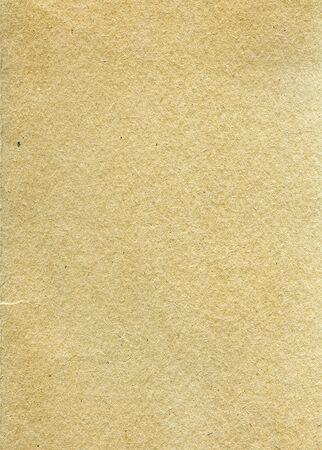 Foto de Textured recycled paper with natural fiber parts - Imagen libre de derechos