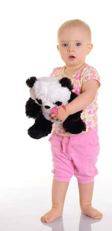 Photo pour Baby holding plush toy over white background - image libre de droit