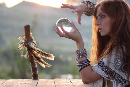 Foto de witch with crystal ball at sunset - Imagen libre de derechos