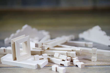 Toy wooden house. The constructor is made of natural wood for ch