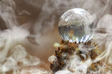 Photo pour A crystal ball in the smoke. A magical accessory in the woods on - image libre de droit