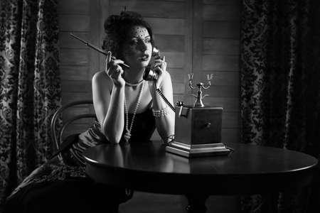 Beautiful 1930's girl smokes monochrome