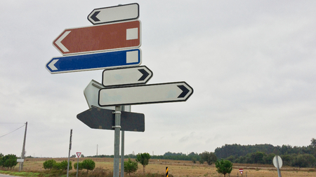 Photo pour traffic signs showing in different directions, lot of ways, variability of choice, crossroads - image libre de droit
