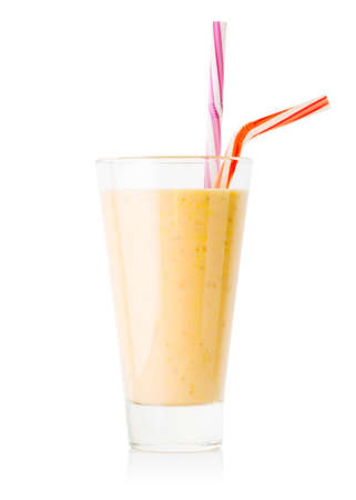 Banana or vanilla smoothie or yogurt in tall glass with two stra