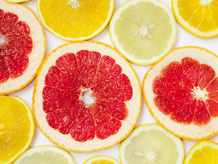 Citrus pattern of orange lemon and grapefruit slices. Different citrus fruits. Colored citrus pattern. Set of useful fruits