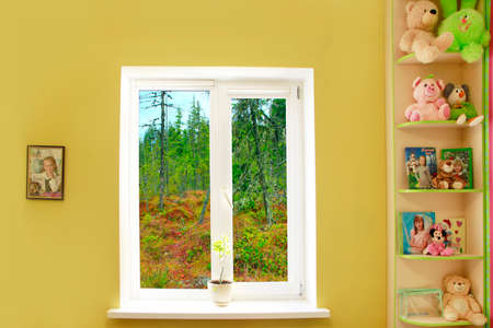 Photo for window in the nursery with a taiga view. Cozy children room and sunset in the window - Royalty Free Image