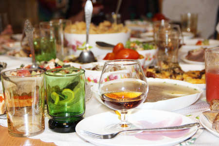Photo pour Holiday table setting. Festive table with delicious dishes. Many food on table for family holiday. Festive food served on table. Set of different meaty and vegetable dishes. Festive dinner at home - image libre de droit