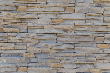 Photo pour The texture of the wall of a variety of colored stones - image libre de droit