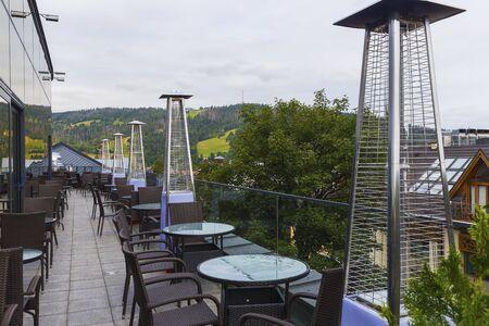 Foto de Devices for heating visitors in an outdoor cafe - Imagen libre de derechos