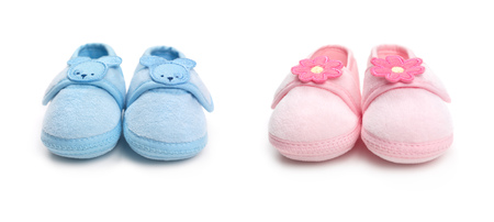 Photo for Closeup of cute pink and blue baby boy and girl shoes isolated on white background - Royalty Free Image
