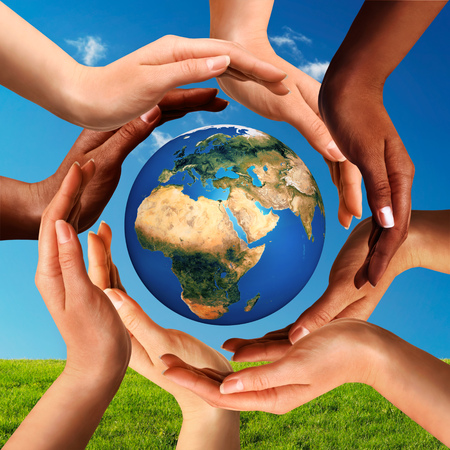 Foto de Conceptual peace and cultural diversity symbol of multiracial hands making a circle together around the world the Earth globe on blue sky and green grass background. - Imagen libre de derechos