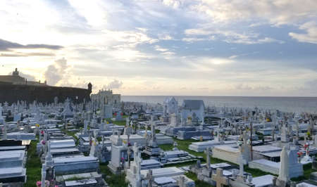 SAN JUAN, PUERTO RICO - SEP, 2017: Overview of the Cementerio de Santa Maria Magdalena de Pazzis cemetery in San Juan, Puerto Rico with the ancient Spanish fort in the background