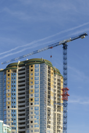 Construction of a multi-storey residential building. Tower crane.
