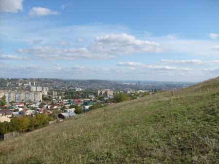 cityscape from the slope of a hill