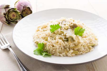 Risotto carciofi, piatto cucina italiana vegetariana