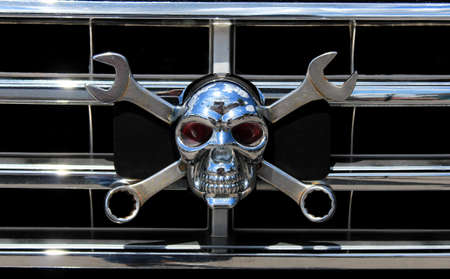 custom metal chrome skull as the Jolly Roger with cross wrenches