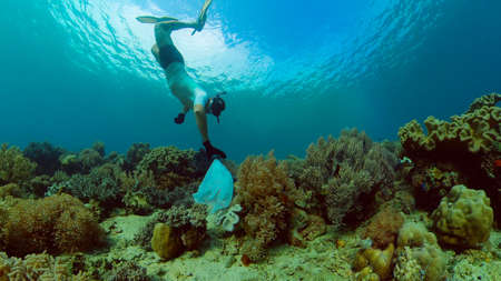 Photo pour Tropical coral reef seascape with fishes, hard and soft corals. Underwater video. Philippines. - image libre de droit