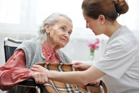 Female nurse is taking care of the senior woman