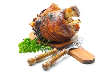 Appetizing Bavarian roast pork knuckle on cutting board