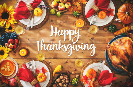 Thanksgiving celebration traditional dinner setting meal concept with Happy Thanksgiving text