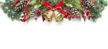 Photo pour Decoration from snowy pine branches, cones, holly and Christmas bells isolated on white - image libre de droit
