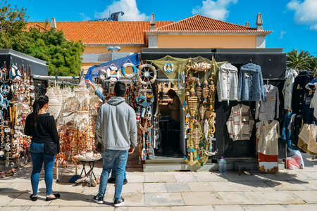 Typical souvenirs and clothes for sale on a market stall in the heart of Cascais, Portugal