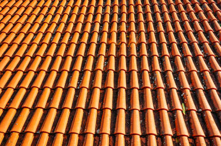 Photo for Brightly lit red tiles roof for background. - Royalty Free Image