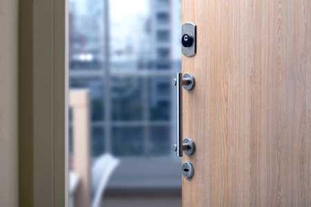Photo for Open door of a family home. Close-up of the lock in an armored door in a department. - Royalty Free Image