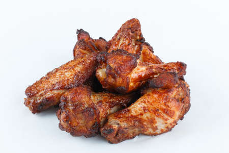 Close up roasted chicken wings on white  background. Cooking chiken wings for holiday party.