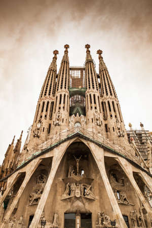Frontal view of this architecture masterpiece, La Sagrada Familia by Antoni Gaudi. Picture without cranes, cleaned digitally. Barcelona.