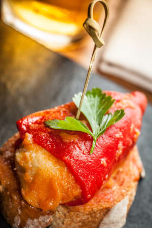 Foto für Typical spanish stuffed pepper called pimientos del piquillo tapas. - Lizenzfreies Bild