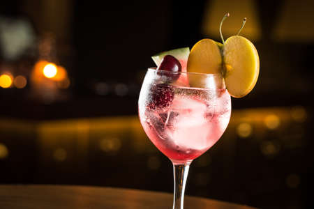Gin Tonic with mix of fruits, cocktail night club.